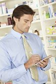 foto of prescription pad  - UK pharmacist in pharmacy with prescription - JPG