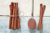picture of cinnamon  - Some cinnamon sticks tied with a natural rope - JPG
