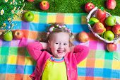 stock photo of healthy eating girl  - Child eating apple - JPG