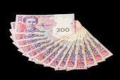 stock photo of payday  - Ukrainian money hryvnias isolated on black background - JPG