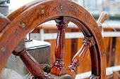 image of ship steering wheel  - Wooden Ship wheel close up on a sailboat. ** Note: Visible grain at 100%, best at smaller sizes - JPG