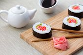 stock photo of soy sauce  - Sushi rolls with ginger - JPG