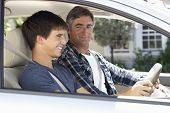 foto of driving  - Father Teaching Teenage Son To Drive - JPG