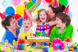 foto of birthday hat  - Happy family celebrating kids birthday - JPG