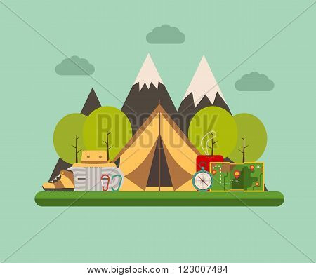 Hiking and climbing concept background. Tramping elements on forest campground landscape. Camping tent sleeping bag compass map climbing rope carabiners tourist hat and shoes.