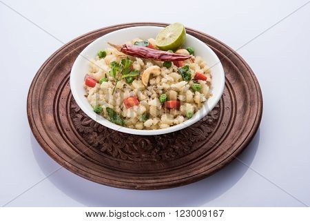 Rava Upma - Popular south Indian breakfast wiih semolina and vegetables, selective focus, Upma or upama is a South Indian breakfast, cooked from dry roasted semolina. seasonings of vegetables