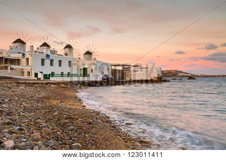 MYKONOS, GREECE - MARCH 06, 2016: Old traditional windmills over the town of Mykonos on March 06, 2016.