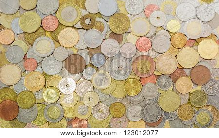 Background of different coins from various countries that are in circulation now and those that were earlier in circulation