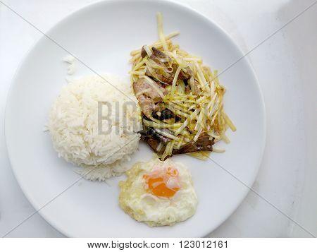 Stir Fried Pork Liver with white Allium Tuberosumand & garlic chives on White Plate. Homemade Idea of Asian Cuisine. Thai food.