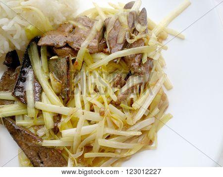 Stir Fried Pork Liver With White Allium Tuberosumand & Garlic Chives On White Plate. Homemade Idea O
