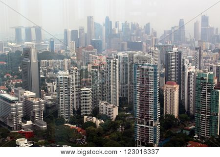 SINGAPORE/SINGAPORE - CIRCA NOVEMBER 2015: View of the Singapore skyline and the Marina Bay Sands from the top of the ION Sky shopping center in Orchard Road