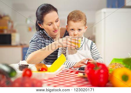 Mother making breakfast for her children in the morning