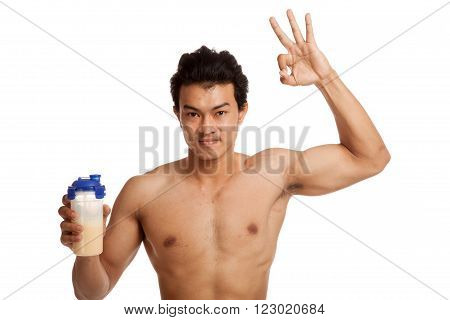 Muscular Asian man  show OK sign with whey protein  isolated on white background