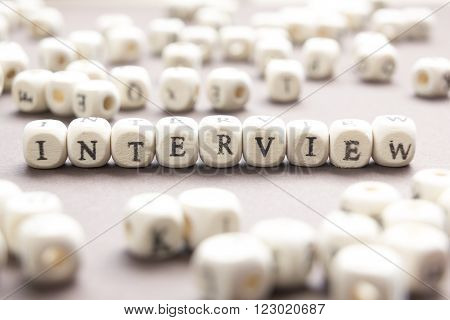 Interview word written on wood block. Wooden Abc.