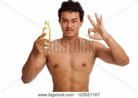 Muscular Asian Man Show Ok  With Electrolyte Drink