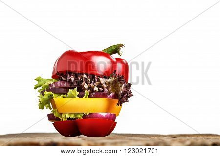 Healthy sandwich with fresh pepper, onion, salad lettuce on wooden background. Detox diet and healthy lifestyle.