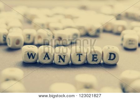 Wanted word written on wood block. Wooden Abc.