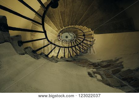 Architecture details of spiral staircases with nice dramatic light, located in Venice Italy