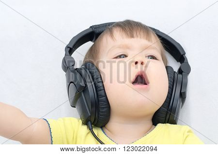 Little Girl With Headphones Singing Song