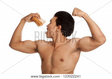 Muscular Asian man load carbohydrate point to bread  isolated on white background