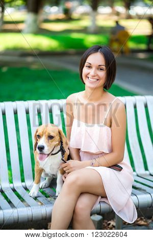 Portrait Of Young Beautiful Woman With A Dog Outdoors