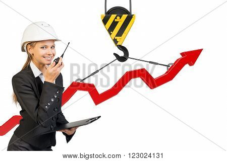Businesslady with walkie-talkie set and graphical chart isolated on white background