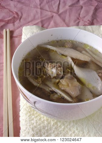 Chinese fish soup with nagaimo slices. Slow cooked soup.