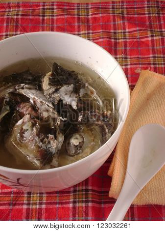 Chinese slow cooked fish soup in bowl.