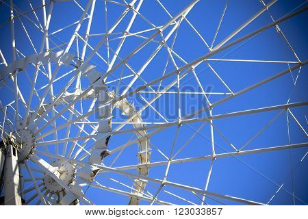 Ferris wheel on the background of clear blue sky. Horizontal shot, background