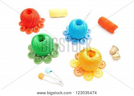 Spools Of Thread, Thimbles And Buttons On White