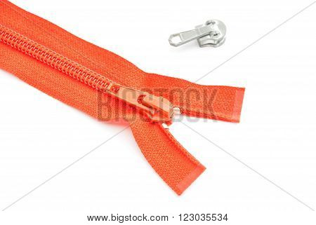 single red zipper on white background closeup