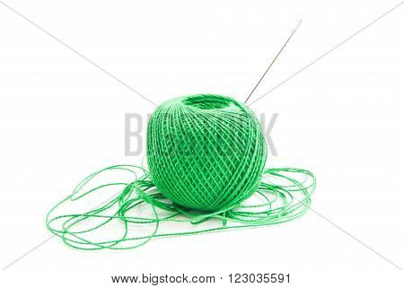 Spool Of Green Thread And Needle