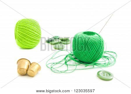 Thread, Thimbles And Green Buttons On White