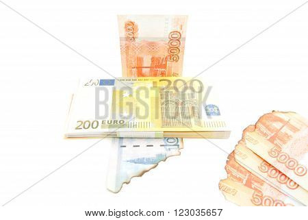 Euros And Burnt Rubles On White