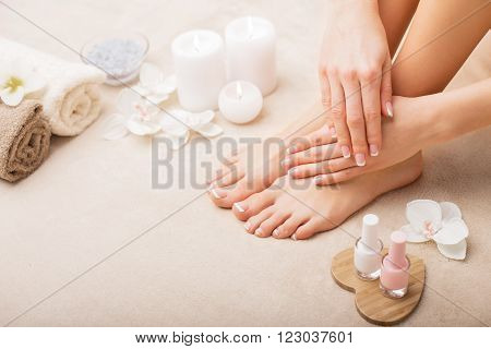 French manicure and pedicure in spa studio set