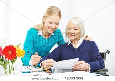 Caring for senior woman with wheelchair in family with granddaughter