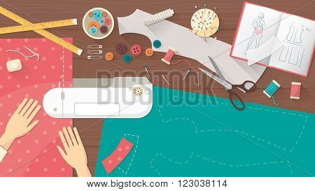 Professional seamstress sewing a dress using a sewing machine tailor work table top view with sewing equipment