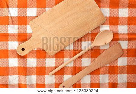 Kitchen kit made from wood on checkered orange white dishtowel