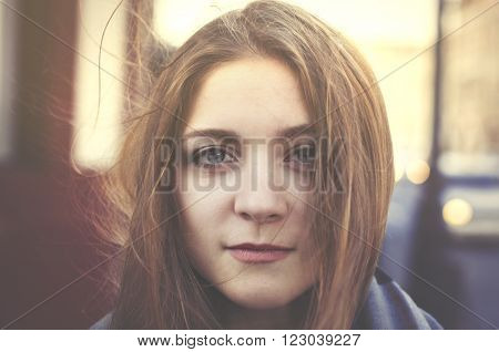 film grained portrait of young pretty woman in a city