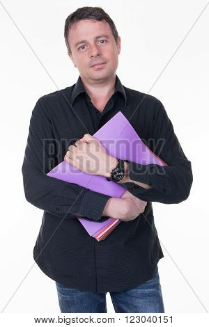 Middle Aged Businessman Standing And Holding A Manila File Folder.