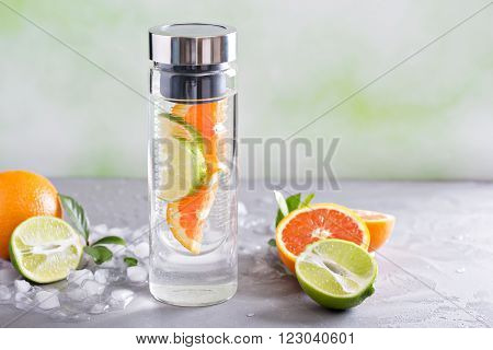 Infused water with orange and lime in a bottle