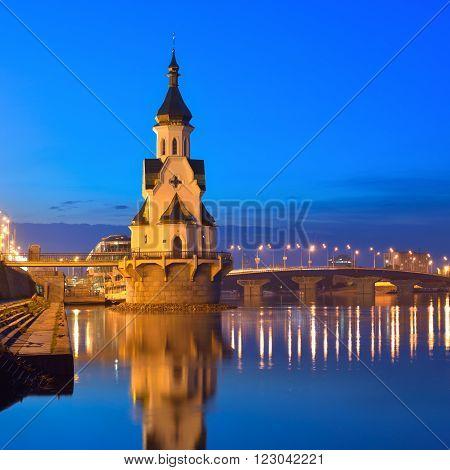 Church of Saint Nicholas (on the water) old embankment and Havanskyi Bridge in Kiev at night. Capital of Ukraine - Kyiv.