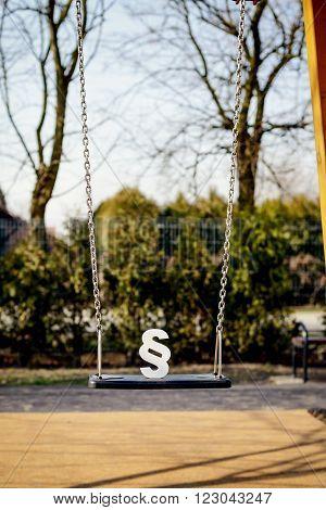 White Paragraph Symbol On Children Chain Swing.