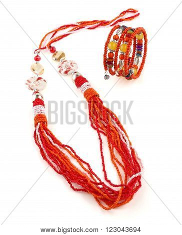 Orange ethnical fashion jewelry on white background