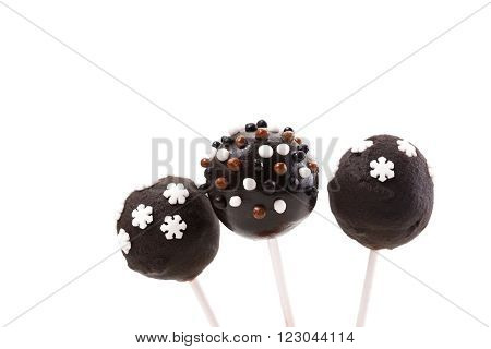 chocolate cakepops with decoration on isolated background