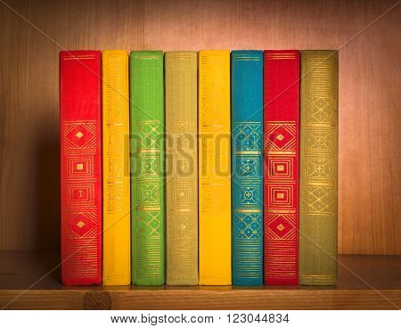 book on shelf, close-up, on wooden background