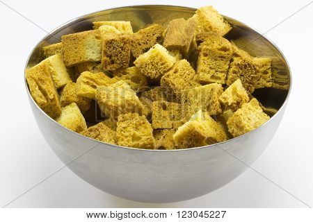 Cubes of bread croutons of white bread for cream soups Stainless steel bowl with toast croutons
