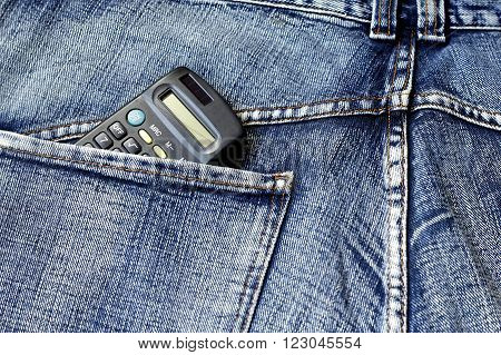 calculator placed in the back pocket of jeans