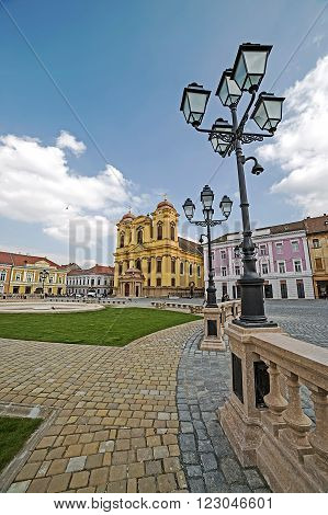 TIMISOARA ROMANIA - MARCH 18 2016: View of one part at Union Square in Timisoara Romania with old buildings and lamps.