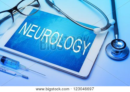 Neurology word on tablet screen with medical equipment on background